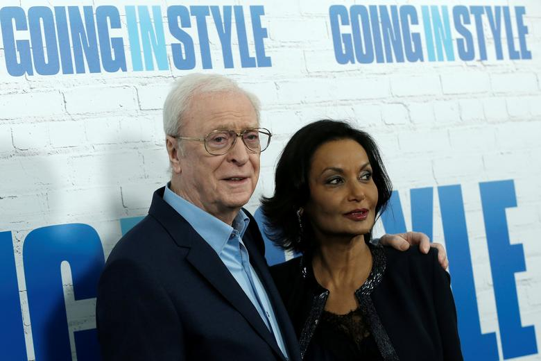 Actor Michael Caine and his wife Shakira pose as they arrive at the premiere of the film 'Going In Style' in New York City, New York, U.S., March 30, 2017.  REUTERS/Mike Segar