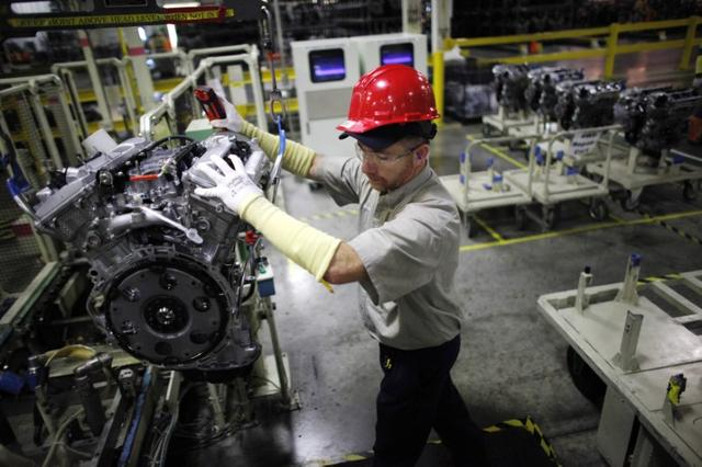 FILE PHOTO: A Toyota automaker employee moves an engine at the Toyota engine assembly line in Huntsville, Alabama November 13, 2009.  REUTERS/Carlos Barria