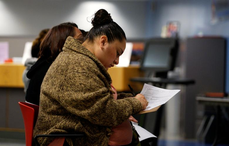 FILE PHOTO - A job seeker fills out an application at a job fair at the Denver Workforce Center in Denver, Colorado, U.S. on February 15, 2017.  REUTERS/Rick Wilking/File Photo
