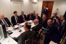 President Trump meeting with his National Security team and being briefed by Chairman of the Joint Chiefs of Staff General Joseph Dunford via secure video after a missile strike on Syria while inside the Sensitive Compartmented Information Facility at his Mar-a-Lago resort in West Palm Beach, Florida. White House Press Secretary Sean Spicer stated that this image has been digitally edited for security purposes.     The White House/Handout via REUTERS