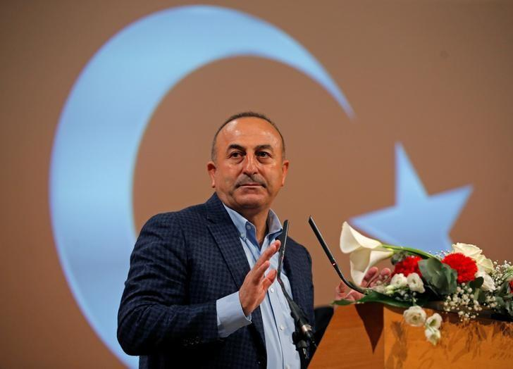 Turkish Foreign Minister Mevlut Cavusoglu addresses supporters during a political rally on Turkey's upcoming referendum, in Metz, France, March 12, 2017. REUTERS/Vincent Kessler/Files