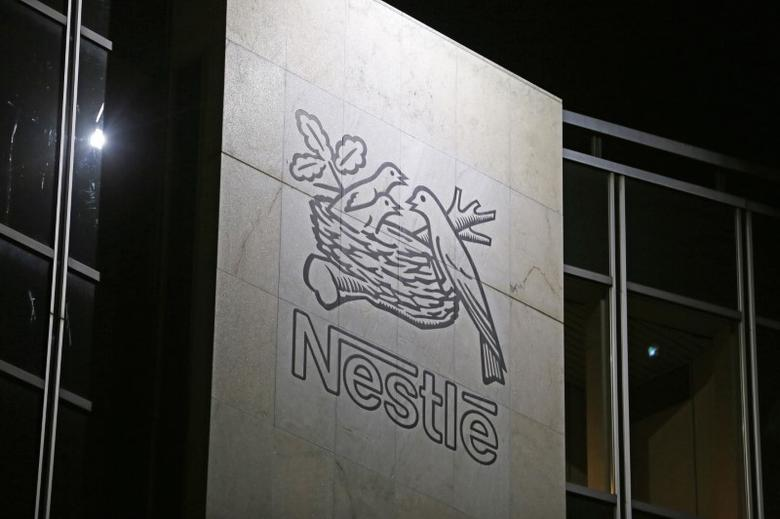 The Nestle logo is pictured on the company headquarters building in Vevey, Switzerland February 18, 2016. REUTERS/Pierre Albouy