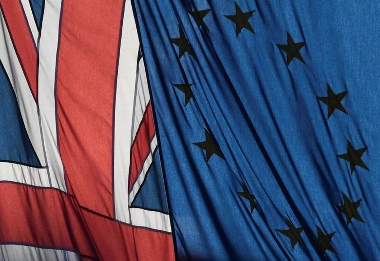 FILE PHOTO: A Union flag flies next to the flag of the European Union in London, Britain, January 24, 2017.   REUTERS/Toby Melville/File Photo