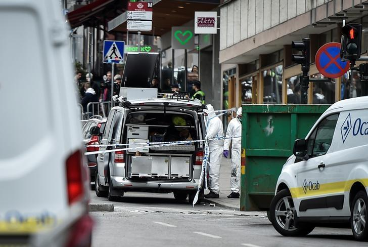 Forensic police investigators work at the crime scene in central Stockholm on April 08, 2017, the day after a hijacked beer truck plowed into pedestrians on Drottninggatan and crashed into Ahlens department store, killing four people, injuring 15 others. TT News Agency/Noella Johansson/via REUTERS