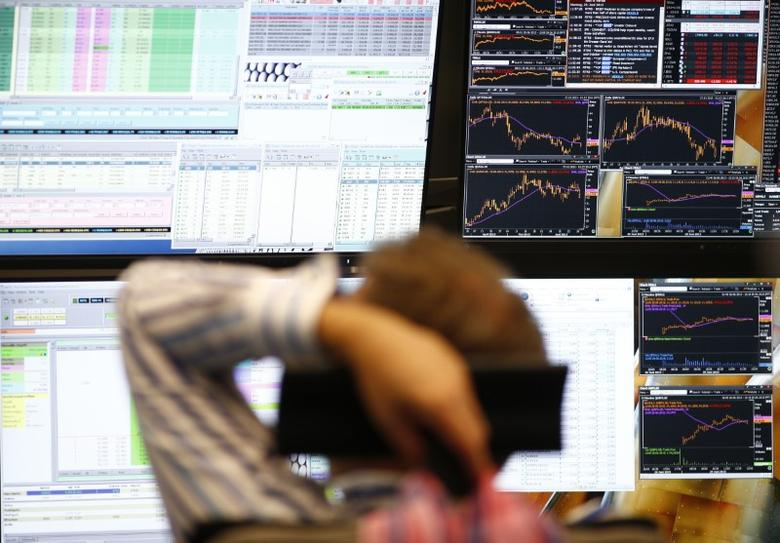 A trader sits in front of the computer screens at his desk at the Frankfurt stock exchange, Germany, June 29, 2015.  REUTERS/Ralph Orlowski