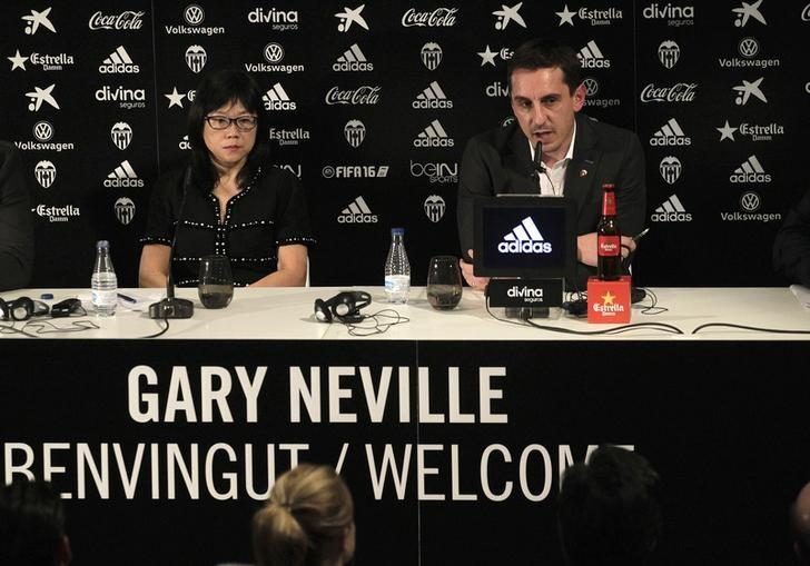 Valencia's new coach Gary Neville (R) attends a news conference next to the club's president Chan Lay Hoon during his presentation at the Mestalla stadium in Valencia, Spain, December 3, 2015. REUTERS/Heino Kalis