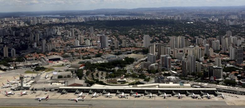 FILE PHOTO: Airplanes are seen at Congonhas airport in Sao Paulo February 12, 2015. REUTERS/Paulo Whitaker