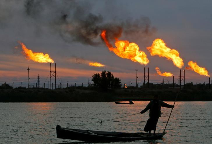 Flames emerge from flare stacks at the oil fields in Basra, Iraq, January 17, 2017. REUTERS/Essam Al-Sudani/File Photo