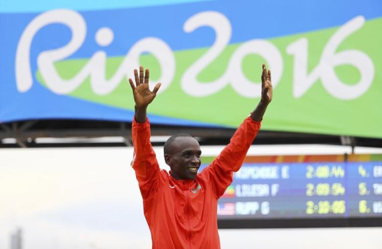 2016 Rio Olympics - Athletics - Final - Men's Marathon - Sambodromo - Rio de Janeiro, Brazil - 21/08/2016. Eliud Kipchoge (KEN) of Kenya celebrates during the flower ceremony after the race. REUTERS/Lucy Nicholson