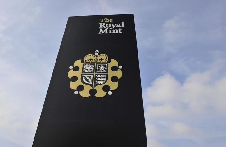 A sign is seen outside the Royal Mint, in Cardiff March 5, 2011.  REUTERS/Toby Melville