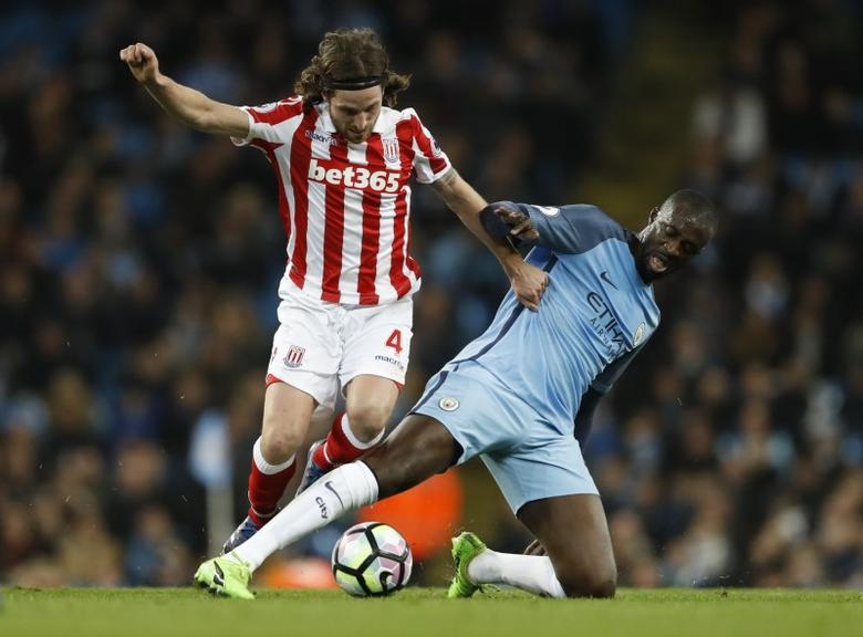 Britain Football Soccer - Manchester City v Stoke City - Premier League - Etihad Stadium - 8/3/17 Manchester City's Yaya Toure in action with Stoke City's Joe Allen  Action Images via Reuters / Carl Recine Livepic