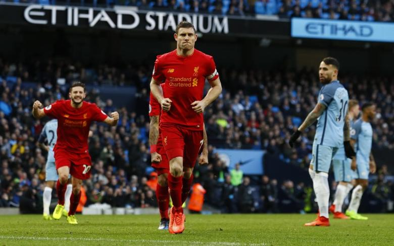 Britain Soccer Football - Manchester City v Liverpool - Premier League - Etihad Stadium - 19/3/17 Liverpool's James Milner celebrates scoring their first goal Action Images via Reuters / Jason Cairnduff Livepic