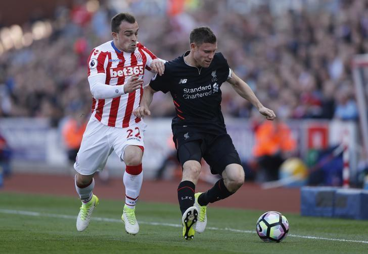 Britain Football Soccer - Stoke City v Liverpool - Premier League - bet365 Stadium - 8/4/17 Liverpool's James Milner in action with Stoke City's Xherdan Shaqiri  Action Images via Reuters / Carl Recine Livepic