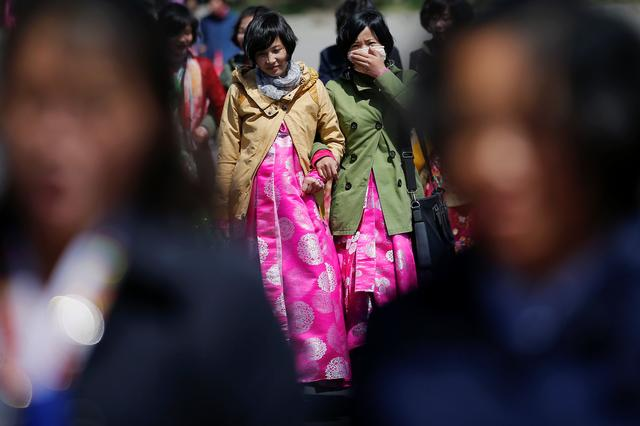 Women wear traditional clothes as North Korea prepares to mark Saturday's 105th anniversary of the birth of Kim Il-sung, North Korea's founding father and grandfather of the current ruler, in central Pyongyang, North Korea April 12, 2017. REUTERS/Damir Sagolj