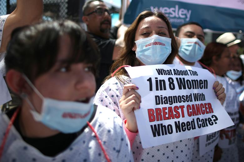 People march in a Save Obamacare rally in Los Angeles. REUTERS/Lucy Nicholson