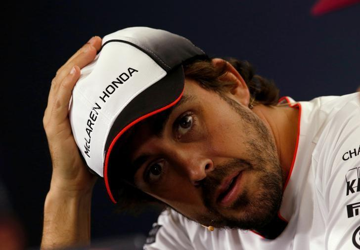 FILE PHOTO: Formula One - Spanish Grand Prix - Barcelona-Catalunya racetrack, Montmelo, Spain - 12/5/16. McLaren's F1 driver Fernando Alonso gestures during a news conference ahead of the Spanish Grand Prix.    REUTERS/Albert Gea/File Photo