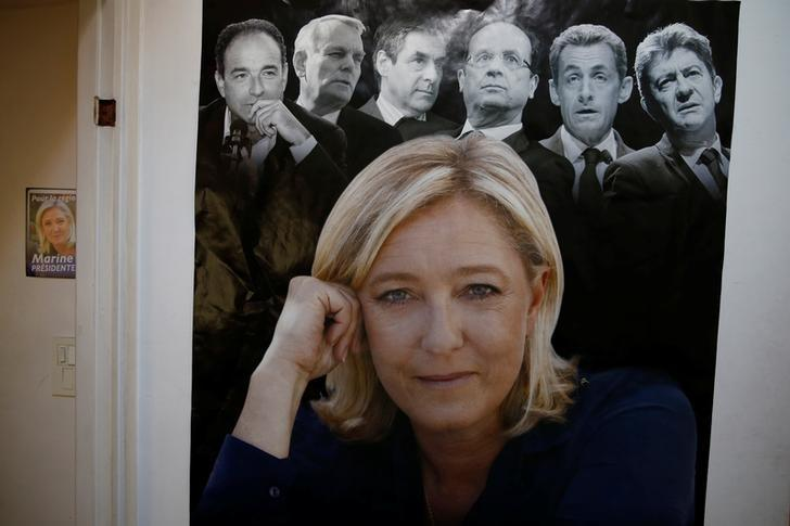 A poster of Marine Le Pen, French National Front (FN) political party leader and candidate for French 2017 presidential election, is seen on a wall at her local headquarters in Henin-Beaumont, France, April 6, 2017. Picture taken April 6, 2017.  REUTERS/Pascal Rossignol