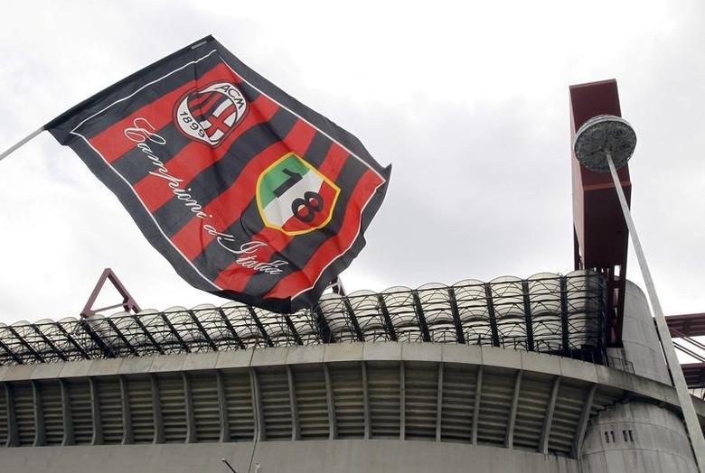 AC Milan's flag waves in front of San Siro stadium in Milan April 29, 2015. REUTERS/Alessandro Garofalo/File Photo