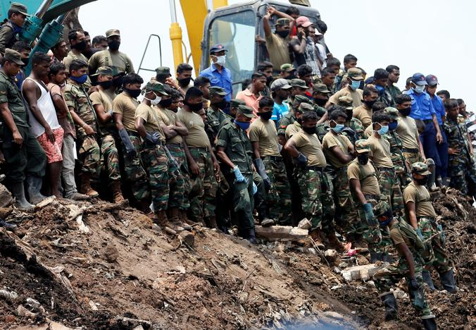 Many feared buried as hopes dim after Sri Lanka garbage dump landslide