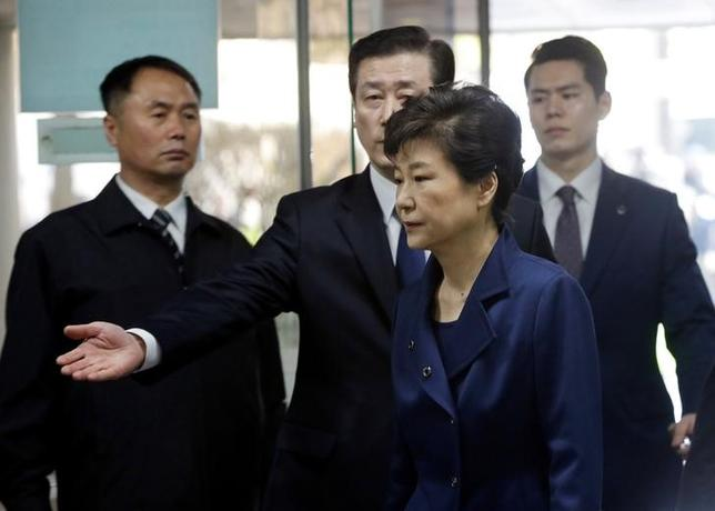 Ousted South Korean President Park Geun-hye arrives for questioning on her arrest warrant at the Seoul Central District Court in Seoul, South Korea, Thursday, March 30, 2017. REUTERS/Ahn Young-Joon/Pool/Files