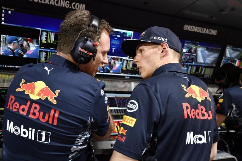 Formula One - F1 - Bahrain Grand Prix - Sakhir, Bahrain - 16/04/17 - Red Bull's Dutch driver Max Verstappen talks to team Chief Christian Horner ahead of the race. REUTERS/Andrej Isakovic/Pool