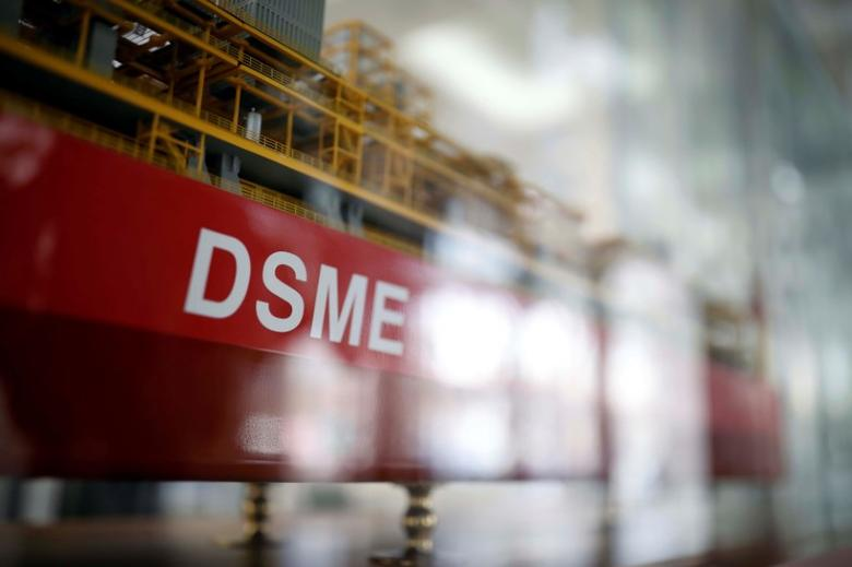 The name of Daewoo Shipbuilding & Marine Engineering Co is seen on a replica ship displayed at its building in Seoul, South Korea, March 24, 2017.   REUTERS/Kim Hong-Ji