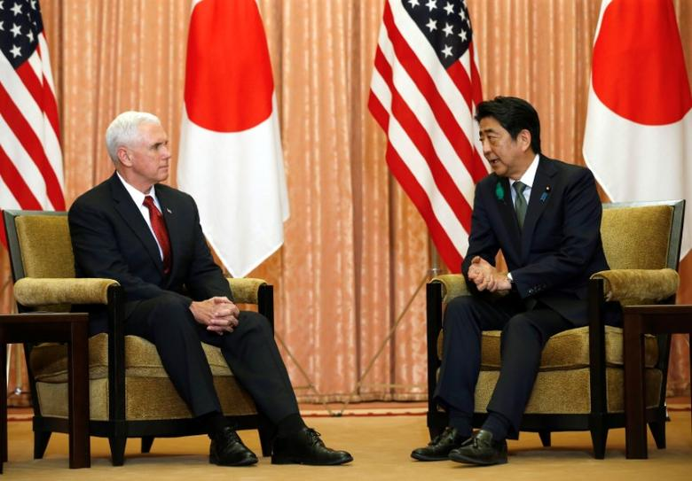 U.S. Vice President Mike Pence (L) talks with Japan's Prime Minister Shinzo Abe during their meeting at Abe's official residence in Tokyo, Japan, April 18, 2017. REUTERS/Kim Kyung-Hoon