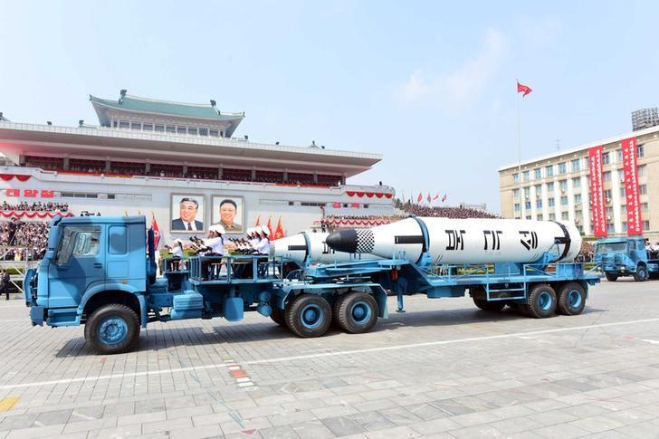 Military vehicles carry missiles with characters reading ''Pukkuksong'' during a military parade marking the 105th birth anniversary of country's founding father Kim Il Sung, in this undated photo, released by North Korea's Korean Central News Agency (KCNA), April 16, 2017. Picture taken April 16, 2017.   REUTERS/KCNA