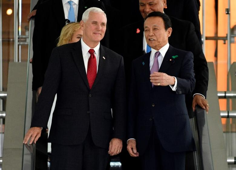 U.S. Vice President Mike Pence (L) listens to Japan's Deputy Prime Minister Taro Aso, on their way to a meeting at Prime Minister Shinzo Abe's (not pictured) official residence in Tokyo, Japan April 18, 2017.  REUTERS/Franck Robichon/Pool