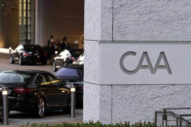 Cars are shown lined up at the valet parking area outside the Creative Artists Agency building in Los Angeles, California, September 24, 2012.  REUTERS/Jonathan Alcorn/Files
