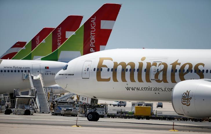 An Emirates plane is seen next to TAP planes at Lisbon's airport, Portugal June 24, 2016. REUTERS/Rafael Marchante/Files