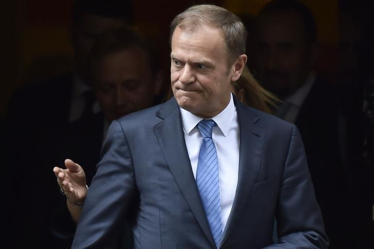 FILE PHOTO: Donald Tusk, the President of the European Council, leaves after meeting Britain's Prime Minister, Theresa May inside 10 Downing Street, in central London, Britain April 6, 2017.   REUTERS/Hannah McKay