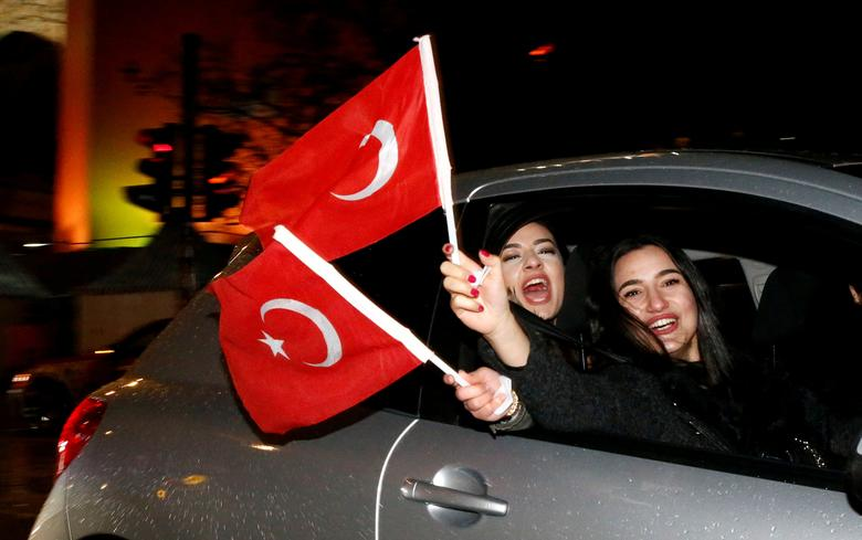 FILE PHOTO: People of the Turkish community living in Germany, supporting Turkish President Tayyip Erdogan celebrate on Kurfuerstendamm boulevard after news bulletins on the outcome of Turkey's referendum on the constitution, in Berlin, Germany, April 16, 2017. REUTERS/Fabrizio Bensch/File Photo