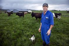 FILE PHOTO - Dairy farmer Keith Trotter stands in a field amongst his herd of cows on his farm in the town of Matakana, located north of Auckland, New Zealand, September 24, 2015.    REUTERS/Nigel Marple/File Photo