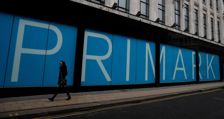 FILE PHOTO: A woman walks past a branch of Primark in Manchester, Britain, February 21, 2017. REUTERS/Phil Noble/File Photo