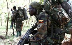 Ugandan soldiers, who are tracking down Lord's Resistance Army (LRA) fugitive leaders, walk in a forest bordering Central African Republic (CAR), South Sudan and Democratic Republic of Congo, near river Chinko April 19, 2012.    REUTERS/Stringer
