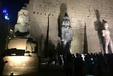 Tourists and Egyptians look at a huge granite statue of King Ramses II (C) after the completion of the restoration work, hours after the Egyptian Ministry of Antiquities revealed the contents of a Pharaonic cemetery on the western bank in Luxor, south of Cairo, Egypt April 18, 2017. Picture taken April 18, 2017. REUTERS/ Sherif Fahmy
