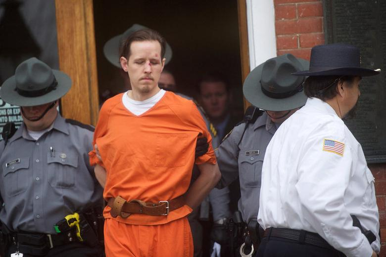 FILE PHOTO --  Eric Matthew Frein exits the Pike County Courthouse with police officers after an arraignment in Milford, Pennsylvania, October 31, 2014.REUTERS/Mark Makela/File Photo