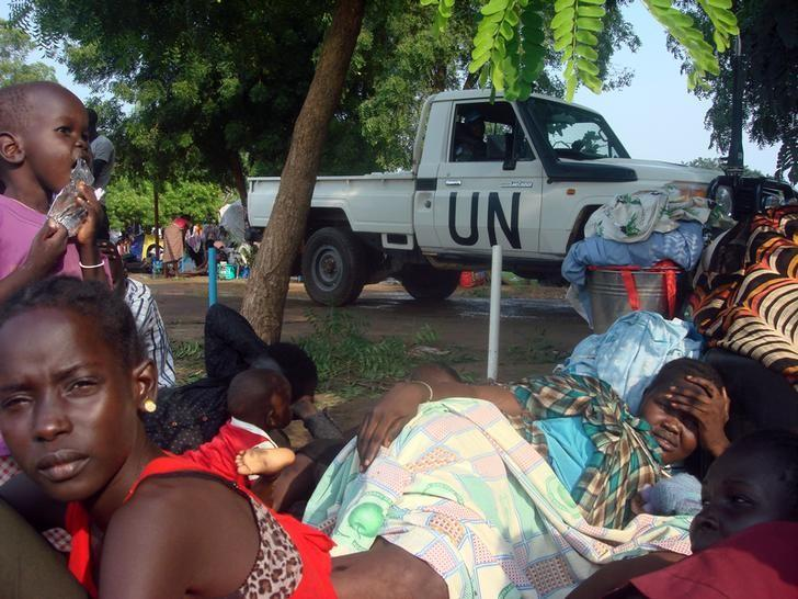 A U.N. truck drives past displaced South Sudanese families resting in a camp for internally displaced people in the United Nations Mission in South Sudan (UNMISS) compound in Tomping, Juba, South Sudan, July 11, 2016. Beatrice Mategwa/United Nations Mission in South Sudan (UNMISS)/Handout via REUTERS