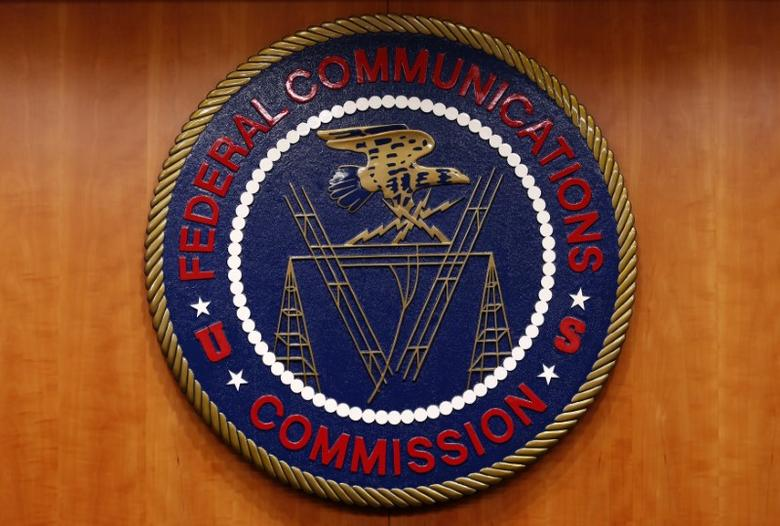 The Federal Communications Commission (FCC) logo is seen before the FCC Net Neutrality hearing in Washington February 26, 2015. REUTERS/Yuri Gripas