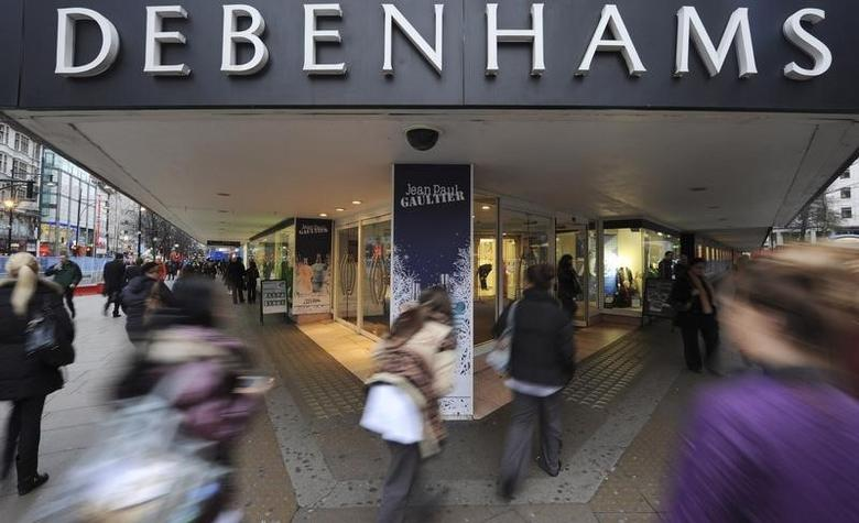FILE PHOTO - People rush past Debenhams department store on Oxford Street, in central London, January 10th 2011. REUTERS/Ki Price