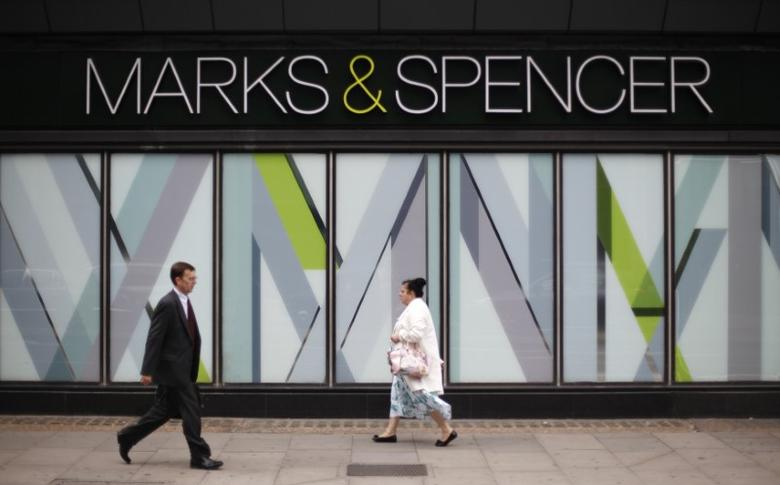 FILE PHOTO - Pedestrians walk past a branch of Marks & Spencer in northwest London, Britain July 8, 2014. REUTERS/Suzanne Plunkett/File Photo