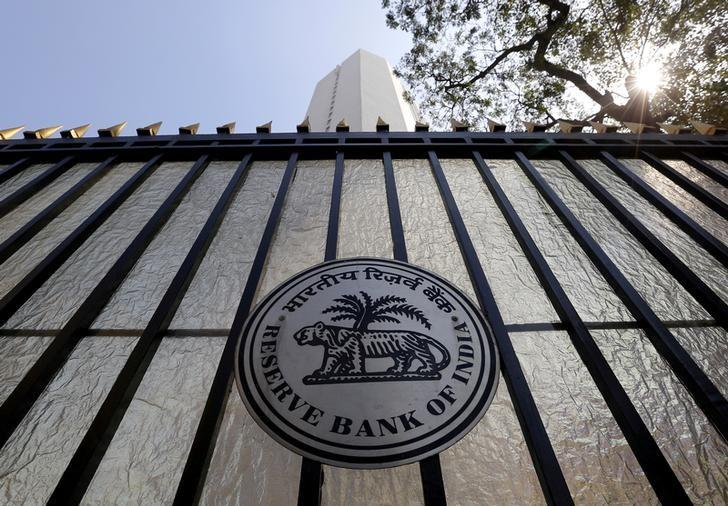 FILE PHOTO: The Reserve Bank of India (RBI) seal is pictured on a gate outside the RBI headquarters in Mumbai, India, February 2, 2016. REUTERS/Danish Siddiqui/File photo