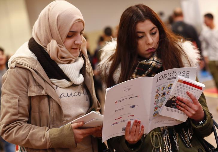 Two women visit the second job fair for migrants and refugees in Berlin, Germany, January 25, 2017.        REUTERS/Fabrizio Bensch