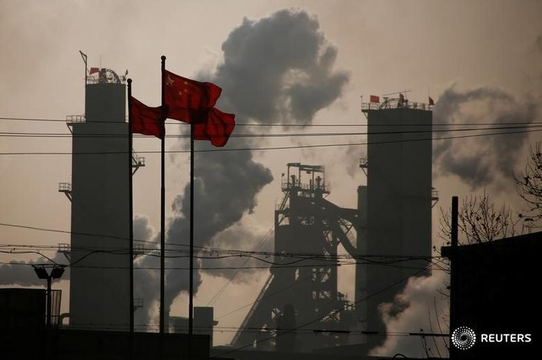 Chinese national flags are flying near a steel factory in Wu'an, Hebei province, China, February 23, 2017.Picture taken February 23, 2017. REUTERS/Thomas Peter - RTS117TK