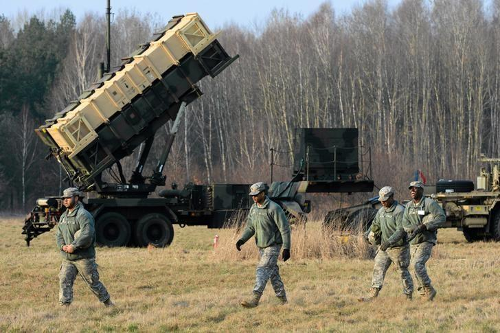 U.S soldiers walk next to  a Patriot missile defence battery during join exercises at the military grouds in Sochaczew, near Warsaw, March 21, 2015.  REUTERS/Franciszek Mazur/Agencja Gazeta/Files