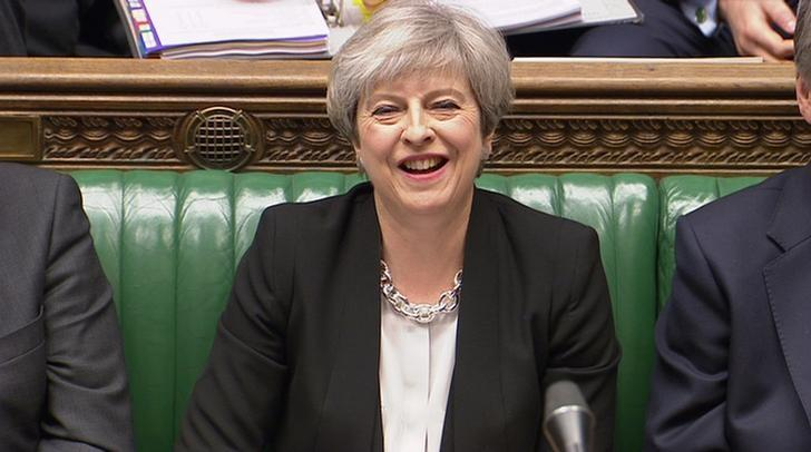 A still image from a video footage shows Britain's Prime Minister Theresa May laughing in the House of Commons in central London April 19, 2017.  Parbul TV/Handout via Reuters TV