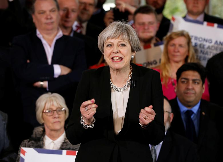 FILE PHOTO: Britain's Prime Minister Theresa May delivers a speech to Conservative Party members to launch their election campaign in Walmsley Parish Hall, Bolton, Britain April 19, 2017. REUTERS/Andrew Yates
