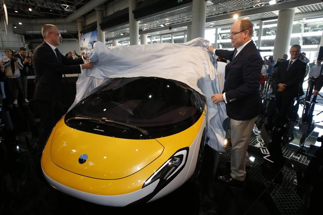 Juraj Vaculík (L), Co-Founder and Chief Executive Officer of AeroMobil, and Prince Albert II of Monaco unveil the AeroMobil flying car during the Top Marques Monaco supercar show in Monaco April 20, 2017. REUTERS/Jean-Paul Pelissier