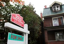 "FILE PHOTO --  A ""Sold over asking"" sign is on display on a house for sale in Toronto's housing market in Toronto, Ontario, Canada, October 21, 2016.  REUTERS/Hyungwon Kang/File Phot"